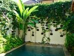 Tropical vines hang from the walls to ensure privacy.