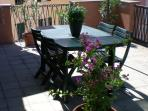 terrace equipped with table and chairs