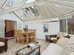 Conservatory with under floor heating and doors to main sitting room, utility room and patio
