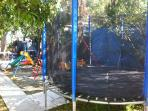 Trampoline and playground in the garden