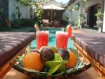 Enjoy fruits and juice by the pool