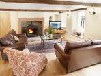 The reception room has a cast iron wood burning fire - a great place to relax after hiking the fells