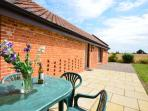 Outside seating area and far reaching countryside views