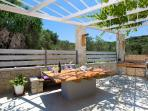 Fully equipped barbecue with sink and dinning table under the pergola