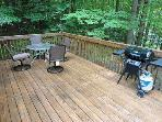 This is the front deck with a table and chairs for outdoor dining!