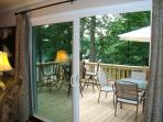 Living room opens to the large deck with plenty of seating and gas grill