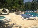 Large pool terrace with 12 sun loungers and double chaise