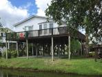 Only a block from the ocean!  The large rear deck overlooks a peaceful canal!