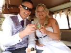 bride and groom toasting their wedding