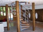 The spiral staircase which takes you to the first floor galleried landing