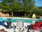 Private fenced-in (for safety) pool with chairs, lounge chairs and pool toys