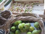 freshly picked figs, cut open to be dried in the sun and preserved for the cold winter months..