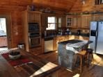 Fully Equipped Kitchen with Stainless Steel Appliances and a Breakfast Bar
