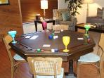 Flip the top onto the pool table, leather side up for a serious game of poker, cards&chips in closet