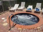 Enjoy the hot tub before taking a dip in the pool.