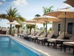 Poolside-features comfy chairs, outdoor tables & bar. Great to rent for parties
