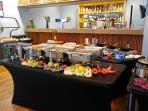 Breakfast buffet served during high season at Tradewinds