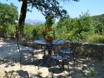 Shaded seating area with a beautiful view over the valley