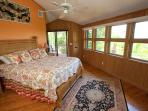 The Master Bedroom with spectacular views over looking tropical gardens and views of the Beach and G