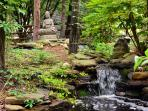 One of the TWO waterfalls and ponds in the tranquil back yard, perfect to enjoy while in the hot tub