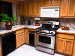 Modern updated kitchen includes a dishwasher, garbage disposal, and all cooking utensils fathomable