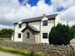 Detached farmhouse surrounded by views of the countryside, Snowdonia mountains & Menai Strait