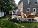Enjoy time in the yard with a deck, outdoor dining table, and gas grill - 17 Woodbine Road Harwich Port Cape Cod New...