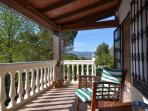 Relax on the balcony over looking the pool and surrounding countryside.