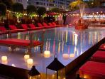 Night falls on the Faena Hotel pool. Open  nightly for cocktails and dinner.