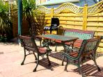 Sunny Patio Garden with Barbecue and furniture