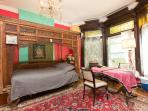 The Red Room with its Balinese bed