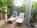 Loungers with sun umbrella to relax while reading and sun tanning