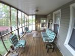 Great screened in porch with a view of the lake