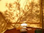 Shadows inside the tent.