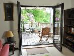 lounge opens onto balcony with sea views