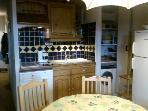Cuisine avec tout le confort:machine à laver,lave vaisselle, frigo congélateur,Micro onde,minifour