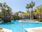 Communal pool is large with plenty of sun beds available