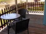 Sitting on the deck, enjoying the peace and quiet of a rural setting.