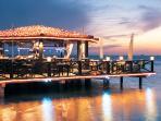 NEARBY:  Pinchos on the Pier Bar and Restaurant.  Sunset Beach.  3-5 min.