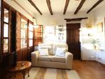Apartment El Lujar sitting area with french windows leading to patio