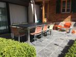 garden with stone table and automatic sunblind