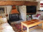 The wonderful inglenook fireplace encourages cosy evenings in front of the fire