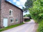 THE OLD SCHOOL ROOM, pet-friendly Grade II listed cottage, working farm, rural r