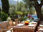 Al fresco dining with views to the pool terrace and mountains