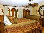 King-size bed in Master bedroom.  Doors open onto lanai.
