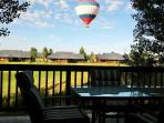 Sip Your Morning Coffee and Watch Hot Air Balloons Off Your Back Deck