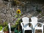 The sheltered patio in the shared area of garden, only shared with upstairs neighbour.