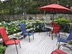 Outdoor deck with plenty of seating, table, umbrella and charcoal grill - 58 Longs Lane Chatham Cape Cod New England...