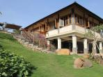 Villa with the lounge and 2 bedrooms on the top and the relaxarea and pool below.