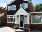 Delightful detached house in Ensbury Park with access to drive for two cars.